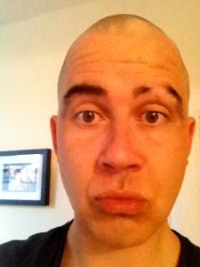 man showing half eyebrow
